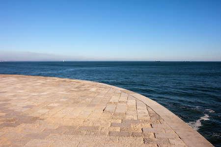 Promenade along the sea on a sunny day.