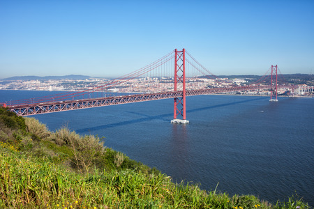 above 25: 25th of April Suspension Bridge over the Tagus river, connecting Almada and Lisbon in Portugal.