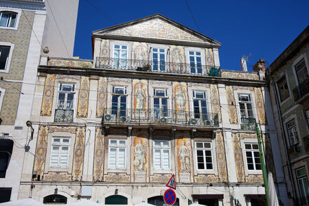 chiado: Tiled building from 1863 in Chiado district of Lisbon, Portugal. Figures on facade represents earth, water, science, agriculture, commerce and industry, star at the top symbolizing the Creator of the Universe.
