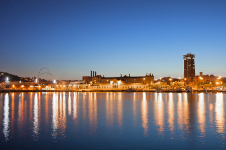 Port view on the Barcelona skyline at night in Catalonia, Spain. photo