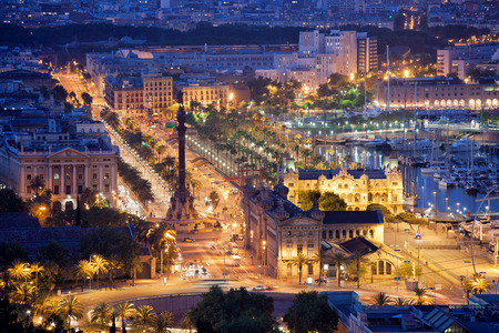Night in the city of Barcelona in Catalonia, Spain. Columbus Monument and boulevard along Port Vell. photo