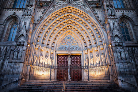 barcelona cathedral: Gothic style portal to the Barcelona Cathedral illuminated at night in Catalonia, Spain.