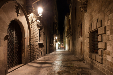 old quarter: Street in old Gothic Quarter (Barri Gotic) of Barcelona at night in Catalonia, Spain. Stock Photo