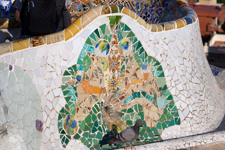 guell: Trencadis broken tile shards abstract mosaic, part of Serpentine Bench at Gaudis Park Guell in Barcelona, Catalonia, Spain.