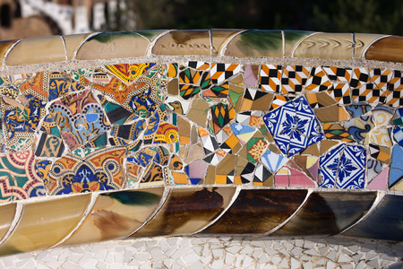 trencadis: Trencadis abstract mosaic from broken tile shards, part of Serpentine Bench at Gaudis Park Guell in Barcelona, Catalonia, Spain. Editorial