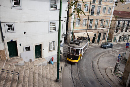traction: Traditional vintage tram nr 28 in old city of Lisbon in Portugal. Editorial