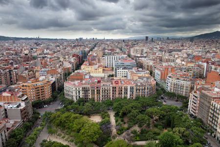City of Barcelona in Catalonia, Spain. View from above, Placa de la Sagrada Familia on the first plan.