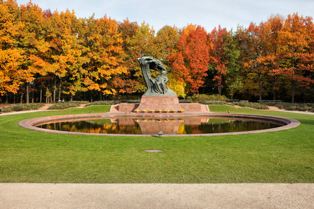 chopin heritage: Fryderyk Chopin monument, designed around 1904 and autumn scenery of the Royal Lazienki Gardens in Warsaw, Poland.