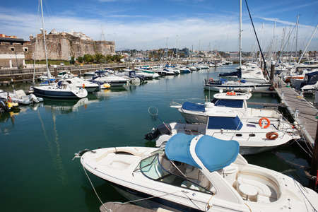 motorboats: Yachts, sail boats and motorboats in marina of Cascais, resort town in Portugal.