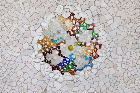 shards: Trencadis mosaic from broken tile shards on the ceiling of Hypostyle Room in Park Guell, Barcelona, Catalonia, Spain.