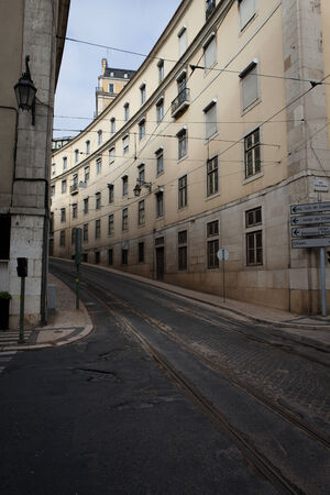 tramline: Street with tramline and historic buildings in the city downtown of Lisbon in Portugal.