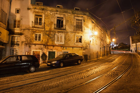 tramline: Old city of Lisbon in Portugal at night, tramline of the famous tram 28 on Largo Santa Luzia street.