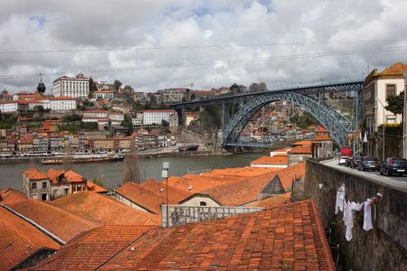 View over picturesque old city of Porto in Portugal, Dom Luis I Bridge over Douro river on far right. photo