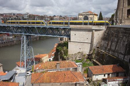 Metro on Dom Luis I Bridge in historic city centre of Porto in Portugal. photo
