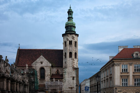 11th century: Church of St. Andrew 11th century Romanesque architecture and tenement houses at dusk in the Old Town of Krakow in Poland. Stock Photo