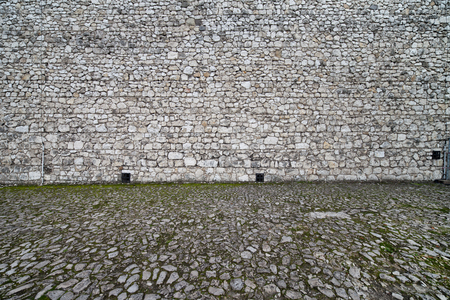 paved: Medieval castle and cobbled square background, made of stone in 14th century.
