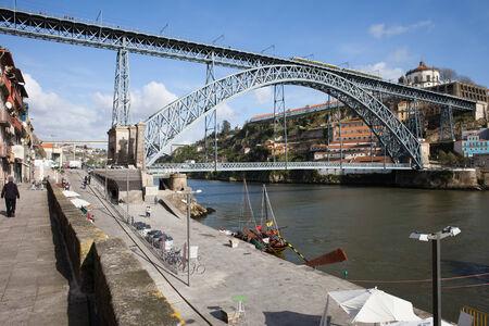 Dom Luis I Bridge and promenade along Douro river in Porto, Portugal. photo