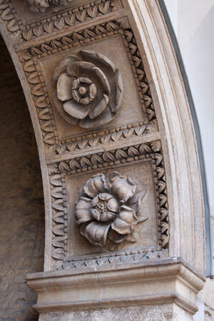stone carving: Flowers stone carvings on arch of the entrance gate