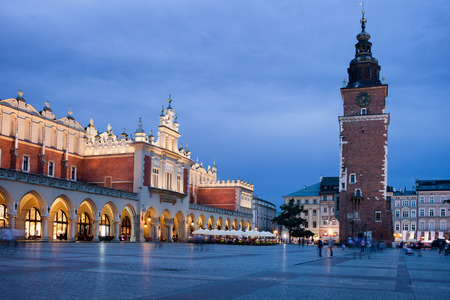 City of Krakow at night in Poland. Cloth Hall (Polish: Sukiennice) and Town Hall Tower on the Main Market Square in the Old Town. photo