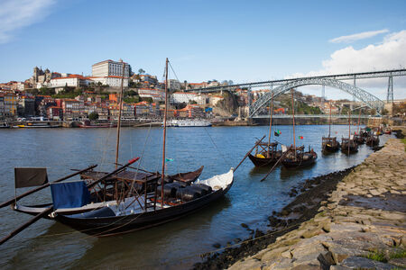 rabelo: Rabelo traditional boats on Douro river, Dom Luis I Bridge and old city of Porto in Portugal. Stock Photo