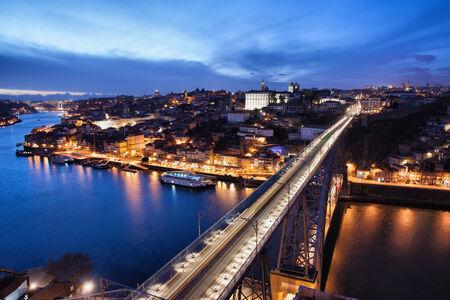 City of Porto at night in Portugal and Dom Luis I Bridge over Douro river. photo