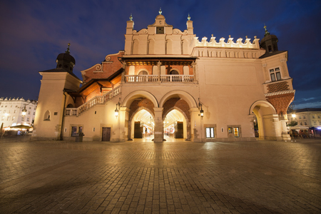 Side view of the Cloth Hall (Polish: Sukiennice) on the Main Market Square in the Old Town of Krakow in Poland. photo