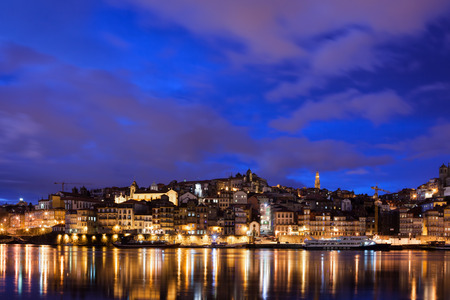 City of Porto skyline at night with reflection on river Douro in Portugal. photo