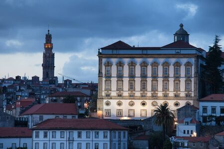 episcopal: Episcopal Palace and Clerigos Church bell tower at dusk in Porto, Portugal.
