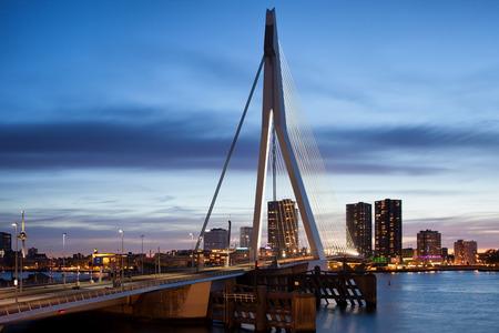 rotterdam: Erasmus Bridge (Dutch: Erasmusbrug) and city skyline of Rotterdam at dusk, Holland, Netherlands.