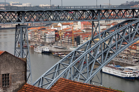 span: View through the span of Ponte Luiz Bridge on Old Town historic architecture in Porto, Portugal.
