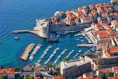 croatia dubrovnik: Old Town of Dubrovnik with marina on Adriatic Sea in Croatia, aerial view.