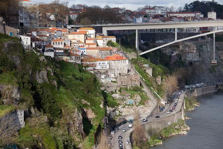d'eiffel: City of Porto in Portugal picturesque urban scenery. Gustave Eiffel Avenue along Douro river and part of Infante D. Henrique Bridge.