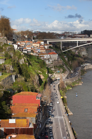 d'eiffel: City of Porto in Portugal. Gustave Eiffel Avenue along Douro river and part of Infante D. Henrique Bridge.