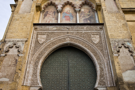 niches: Mezquita Cathedral architectural details in Cordoba, Spain. Moorish arches, niches with Christian frescos.