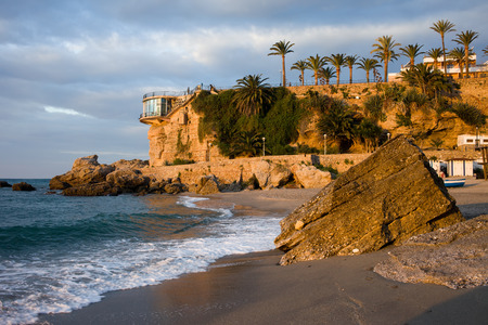balcon: Sunrise at Playa Calahonda beach by the Balcon de Europa viewpoint in Nerja, resort town on Costa del Sol in Spain. Stock Photo