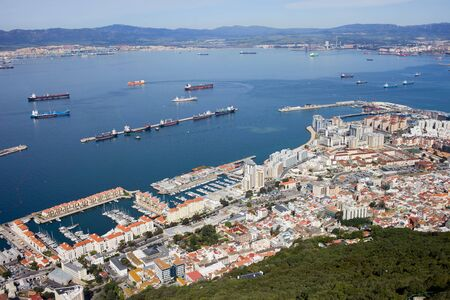 tenement buildings: Aerial view over Gibraltar city and bay.