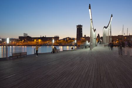 promenade: Barcelona in the evening, Rambla de Mar city promenade over Port Vell in Catalonia, Spain. Stock Photo