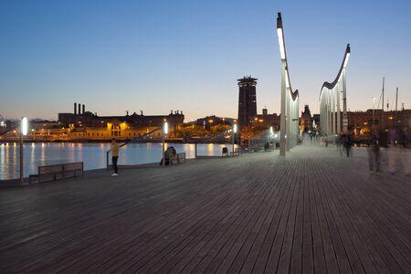 rambla: Barcelona in the evening, Rambla de Mar city promenade over Port Vell in Catalonia, Spain. Stock Photo