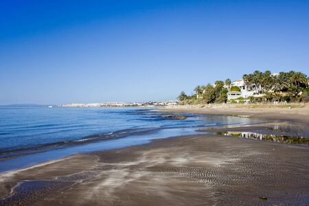 sol: Tranquil, empty beach in Marbella, resort town on Costa del Sol in Spain.