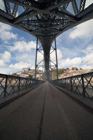 vanish: Street on lower floor of the Ponte Luiz I arch bridge in Porto, Portugal. Stock Photo