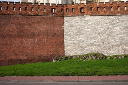 fortification: Half brick and half stone medieval wall of the Wawel Royal Castle fortification in Krakow Poland.