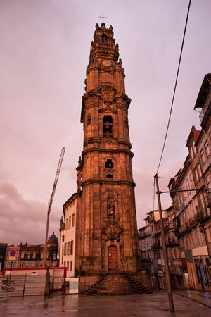 historical landmark: Porto in Portugal Clerigos Church bell tower at sunset in the Old Town.