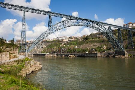 maria: Maria Pia Bridge in Porto Portugal wrought iron railway arch bridge over Douro river opened in 1877 construction of Gustave Eiffel.