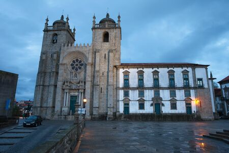 romanesque: Porto Cathedral at dusk in Portugal city landmark founded in 12th century Romanesque and Baroque architecture.