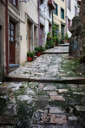 sloping: City of Porto in Portugal sloping narrow medieval alley with traditional houses in the Old Town.