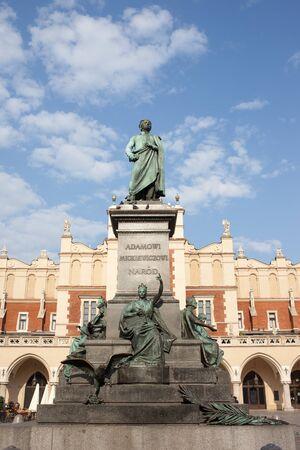 Poland, Krakow, Old Town, Adam Mickiewicz Monument - Polish Romantic poet and Cloth Hall (Sukiennice). photo