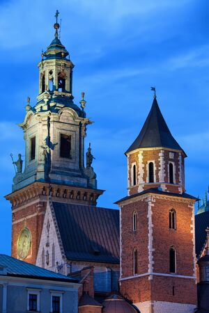 national historic site: Wawel Royal Cathedral (Polish: Katedra Wawelska, na Wawelu) by night in Cracow, Poland, Clock Tower and Silver Bells Tower. Stock Photo