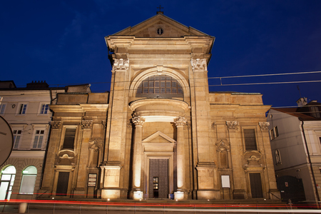 historic site: Church of Conversion of Saint Paul by night in Krakow, Poland, 18th century Baroque style architecture.