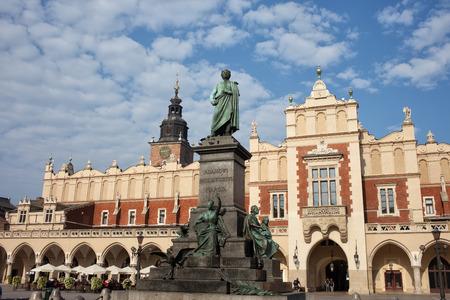 Poland, Krakow, Old Town, Adam Mickiewicz Monument and Cloth Hall (Sukiennice). photo