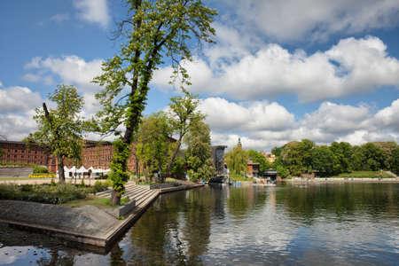 riverside tree: Mill Island (Wyspa Mlynska) and Brda River in city of Bydgoszcz, Poland. Stock Photo